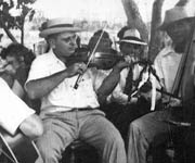 Ed Marshall with fiddle and other unknown musicians