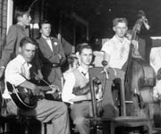 Joe Kujawa on fiddle with other unknown musicians at Raymond Ohendalski and Louise Kasowski wedding in 1949