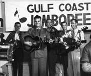 Clem Kujawa playing fiddle with Utah Carl and the Gulf Coast Playboys in Channel 13 Studios in Houston in 1958.